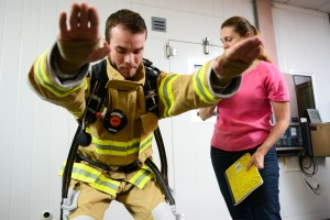Man wearing fire fighter turn out suit