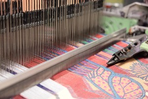 Woven fabric on a loom