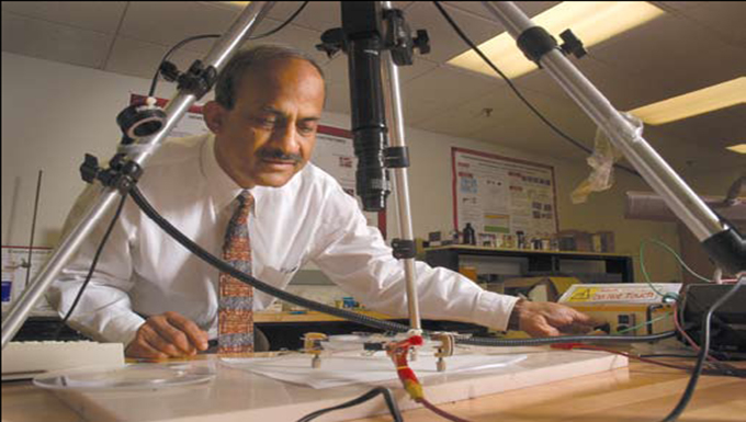 Textiles' Dr. Tushar Ghosh examines micro fiber used in creating artificial muscle.