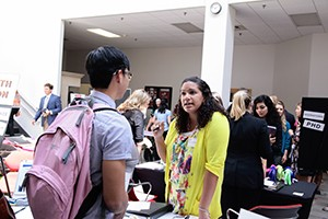 Student speaks with a representative at a career fair