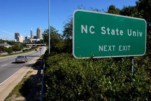 NC State University Exit Sign with Raleigh Skyline