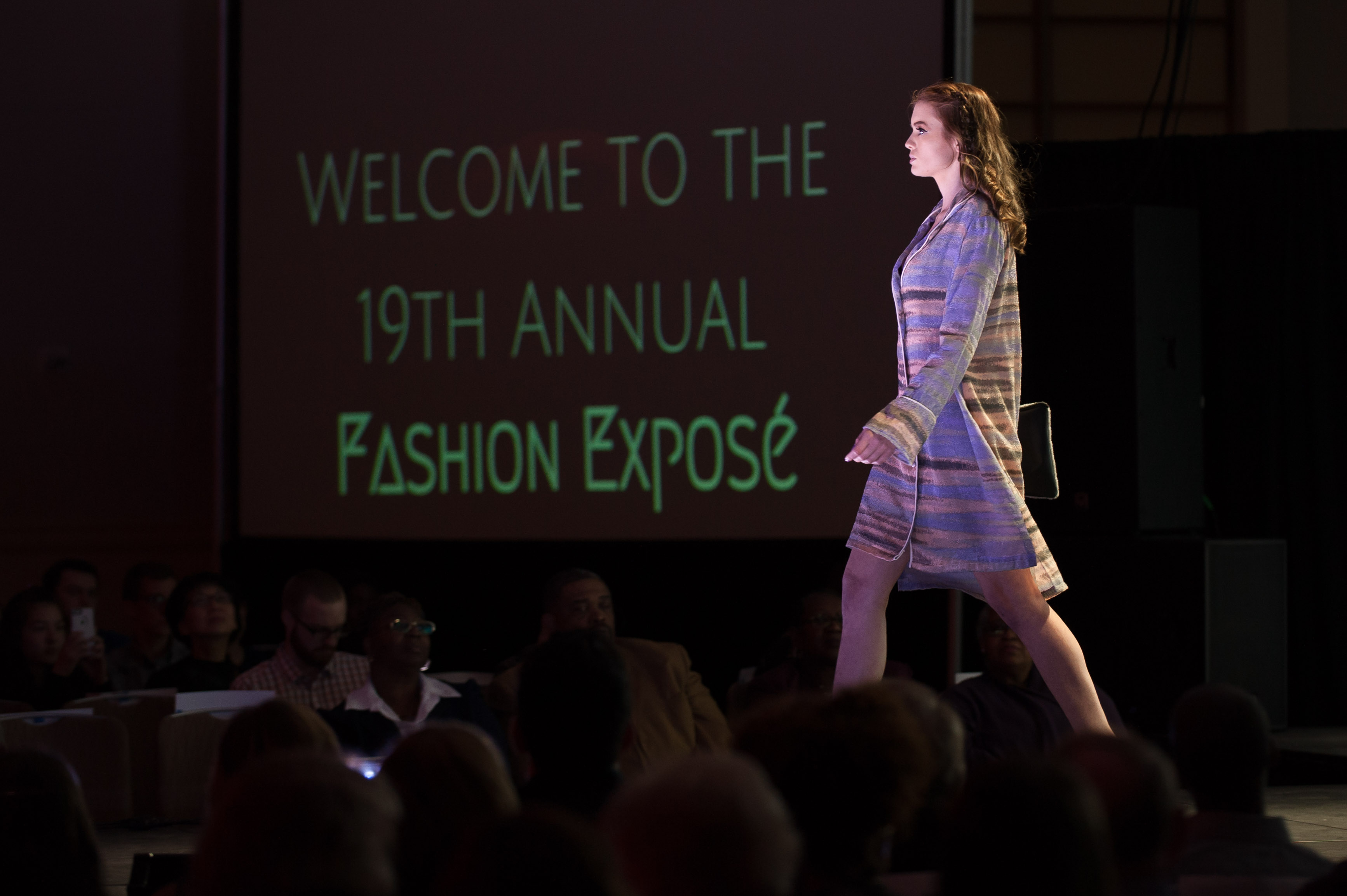 AATS model walking runway in striped dress