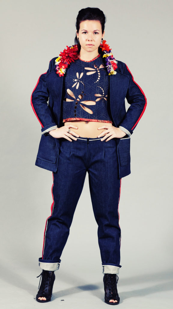 Model wearing denim pants, jacket, and top with dragonfly cut-outs.
