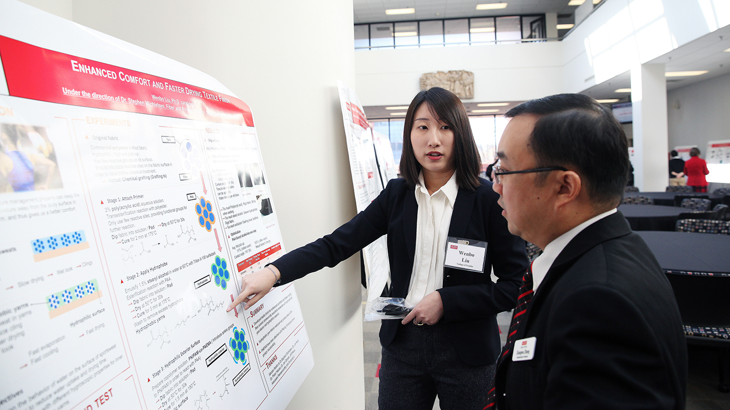 students presenting her poster presentation