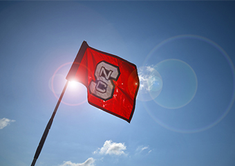 Red flag with NC state logo