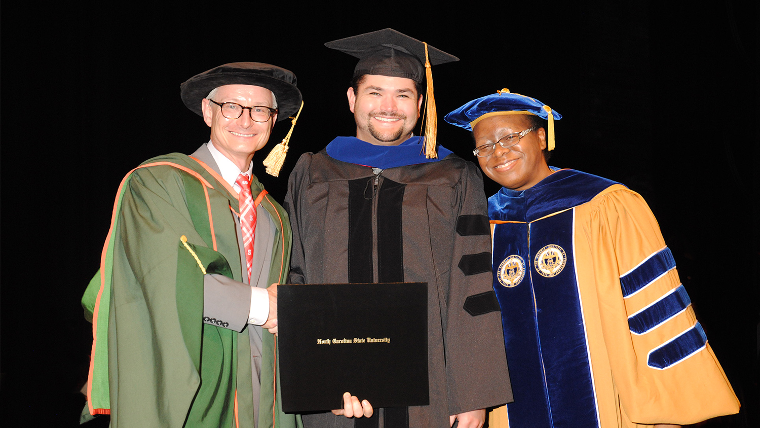 Dean Hinks, Dr. Charles Blackwell (FPS'15) and his adviser Dr. Ecrika Ford
